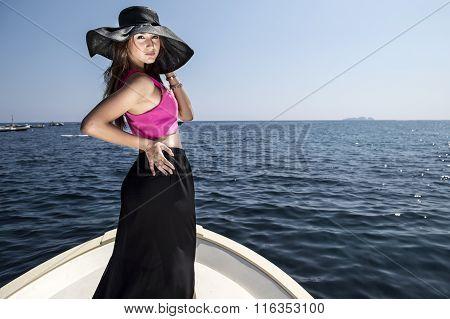 Posing girl on boat at Positano