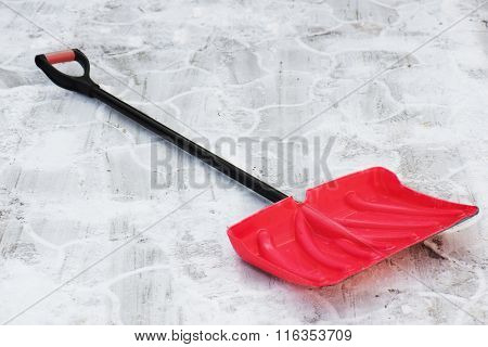 Red Plastic Shovel For Snow Removal.