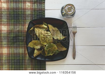 Coffee Leaves A Dish On The Table