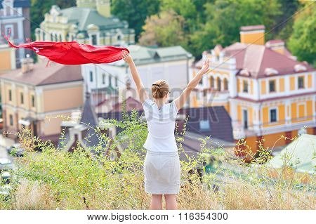 Free Happy Woman Waving A Red Handkerchief