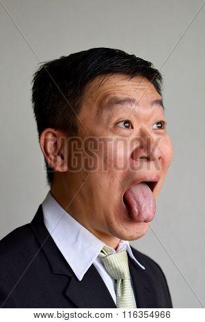 Mature Asian Man in weird shocking expression