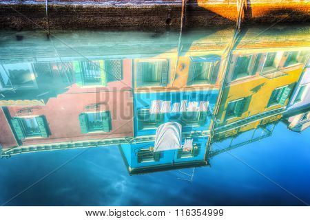 Colorful Buildings Reflected On The Water In Burano