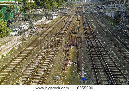 Old Rusty Rails Leading To Mumbai Central Station With Spare Rails In The Middle