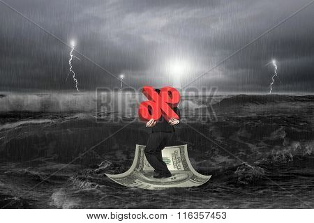 Businessman Carrying 3D Percentage Symbol On Money Boat With Storm