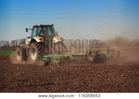 Tractor Cultivator Raises Great Dust On Soil