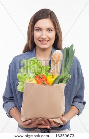 Attractive fit girl with fresh healthy food
