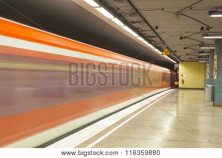 HAMBURG, GERMANY - JUNE 6, 2013: metro station with red train in Motion