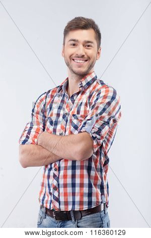 Attractive fit guy is expressing positive emotions