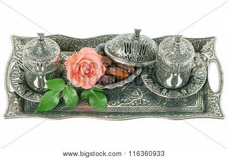 Tea table setting withdates mint leaves and rose flower. Ramadan karim. Oriental hospitality concept