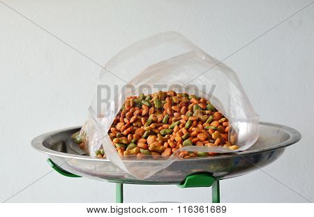 pet food in plastic bag on iron weighing scale tray