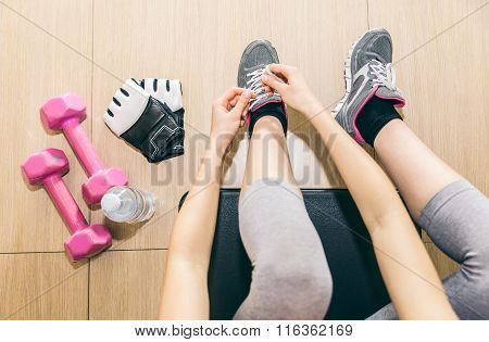 Woman Tying Her Shoelaces Before Hard Training