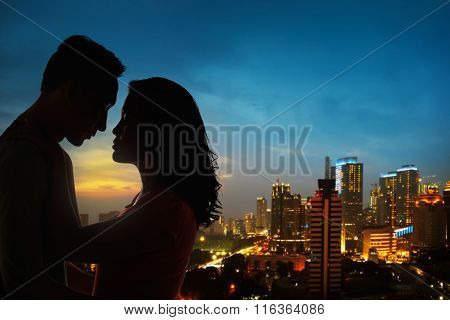 Silhouette Of Couple On The Rooftop