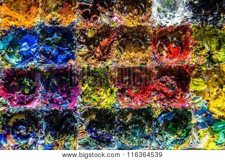 Oil paints of different colors on the palette
