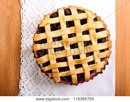 Sour Cherry Lattice Pie Over Napkin