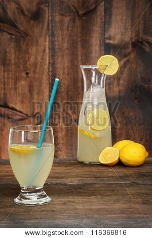 glass lemonade with blue straw