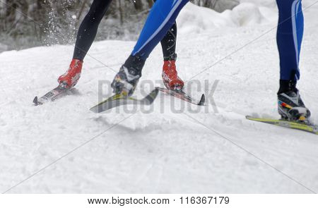 Close Up Of Speedy Colorful Skies, Feet And Legs Of A Cross Country Skier