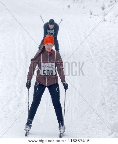 Cross Country Skiing Girl Followed By A Man In The Beautiful Pine Forest