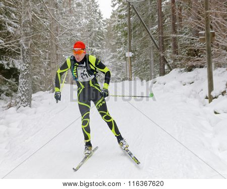 Focused Cross Country Skiing Man In The Beautiful Forest