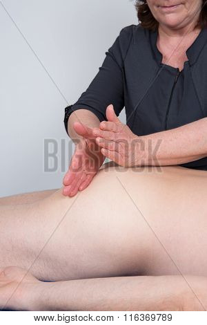 Macro Close Up Of Hands Massaging Male Abdomen.