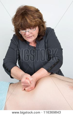 Man Having Abdomen Visceral Massage By A Therapist