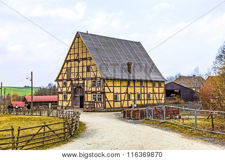 ANSPACH, GERMANY - OCT 6, 2014: old farm house in the Hessenpark under cloudy sky
