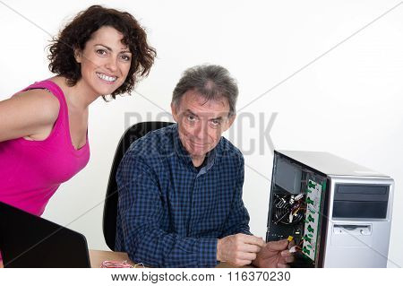 Man Fixing Computer With Woman Watching It