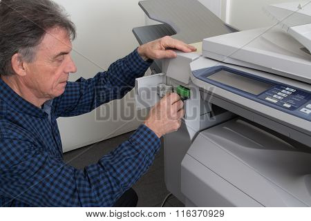 Cropped Image Of Businessman's Hand With  Printer At Office