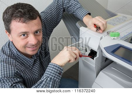 Handyman Fixing The Office Printer Or Copy Machine
