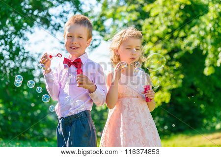 Brother And Sister 6 Years In The Park With Soap Bubbles
