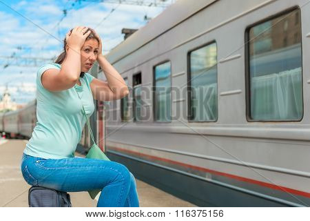 Emotional Woman Looks At The Departing Train On Which She Was Late
