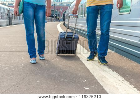 Feet Walking On The Platform Passengers With A Suitcase