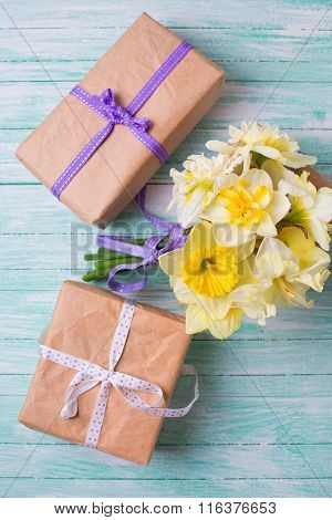 Bunch Of Fresh  Spring Yellow Daffodils  Flowers And Wrapped Gift Boxes