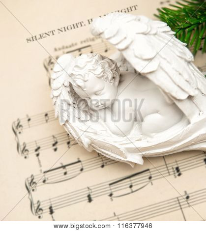 Little Lovely Sleeping Angel With Christmas Decoration