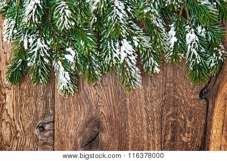 Christmas Tree Branches Over Wooden Background. Green Border