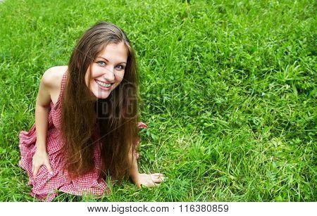 Beautiful woman in summer park