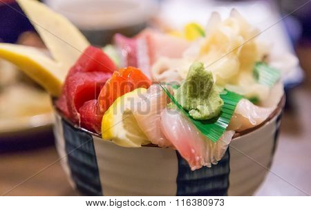 a chirashi - raw fish over rice bowl.