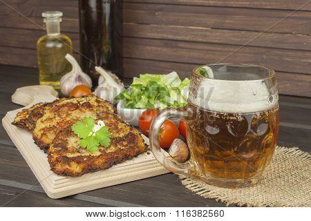 Fried potato pancakes with garlic. Traditional Czech food. Preparing homemade food.