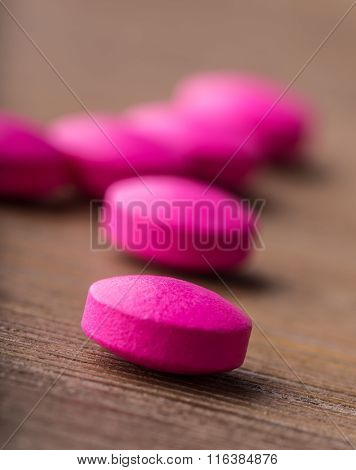 Pills. Tablets. Capsule. Heap of pills. Medical background. Close-up of pile of yellow pink green