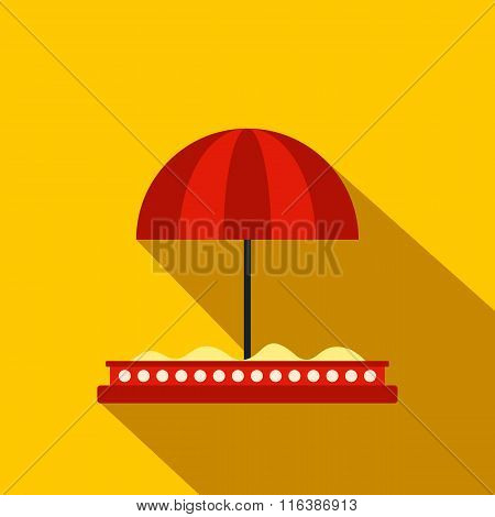 Children sandbox with red umbrella flat icon