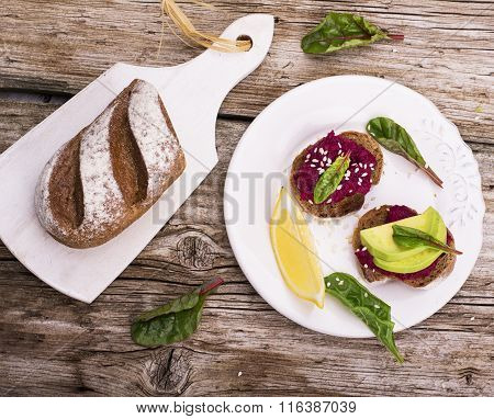 Sandwiches for breakfast or snack of hummus with roasted beets