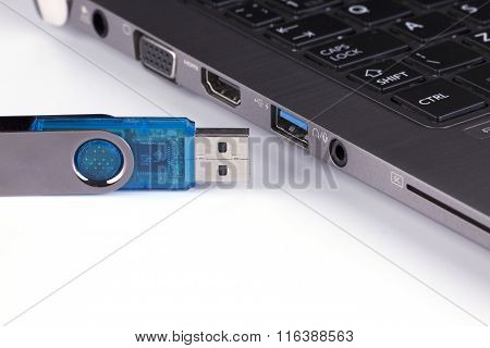 Blue Flash Disk And Laptop With Usb Slot