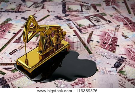 Gold Pumpjack And Spilled Oil On Saudi Riyals