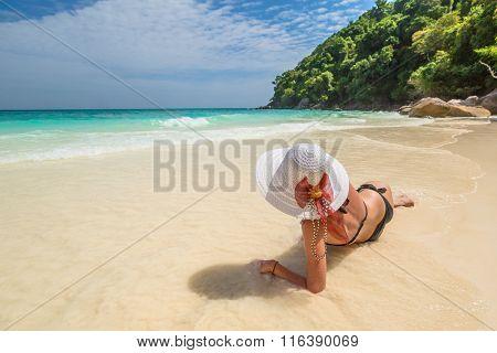 Woman on tropical white beach