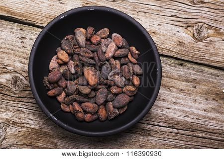 Simple Black bowl full of dried cocoa