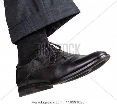 Male Right Foot In Black Shoe Takes Step
