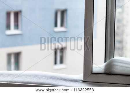 Snow On Home Window Casement And House In Winter