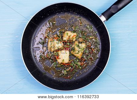 Frying pan with the leftovers of a fried fish