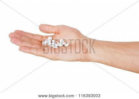 Hand Holding Pills Isolated On White Background