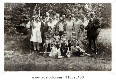 Vintage Photo: Middle Age And Young People Posing Outdoors