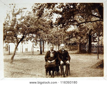 Vintage photo: husband and wife posing outdoors